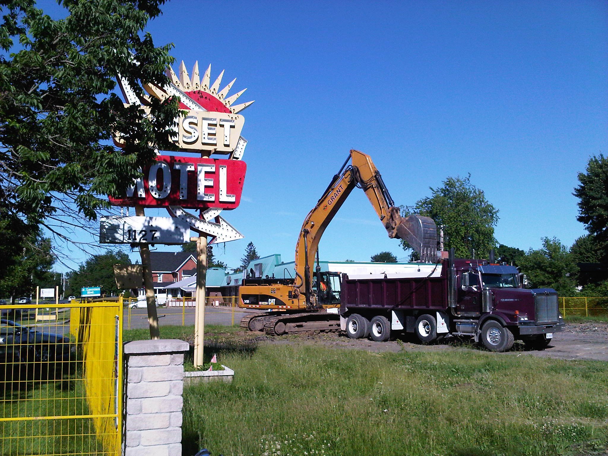 A backhoe works on the Sunset Motel site.