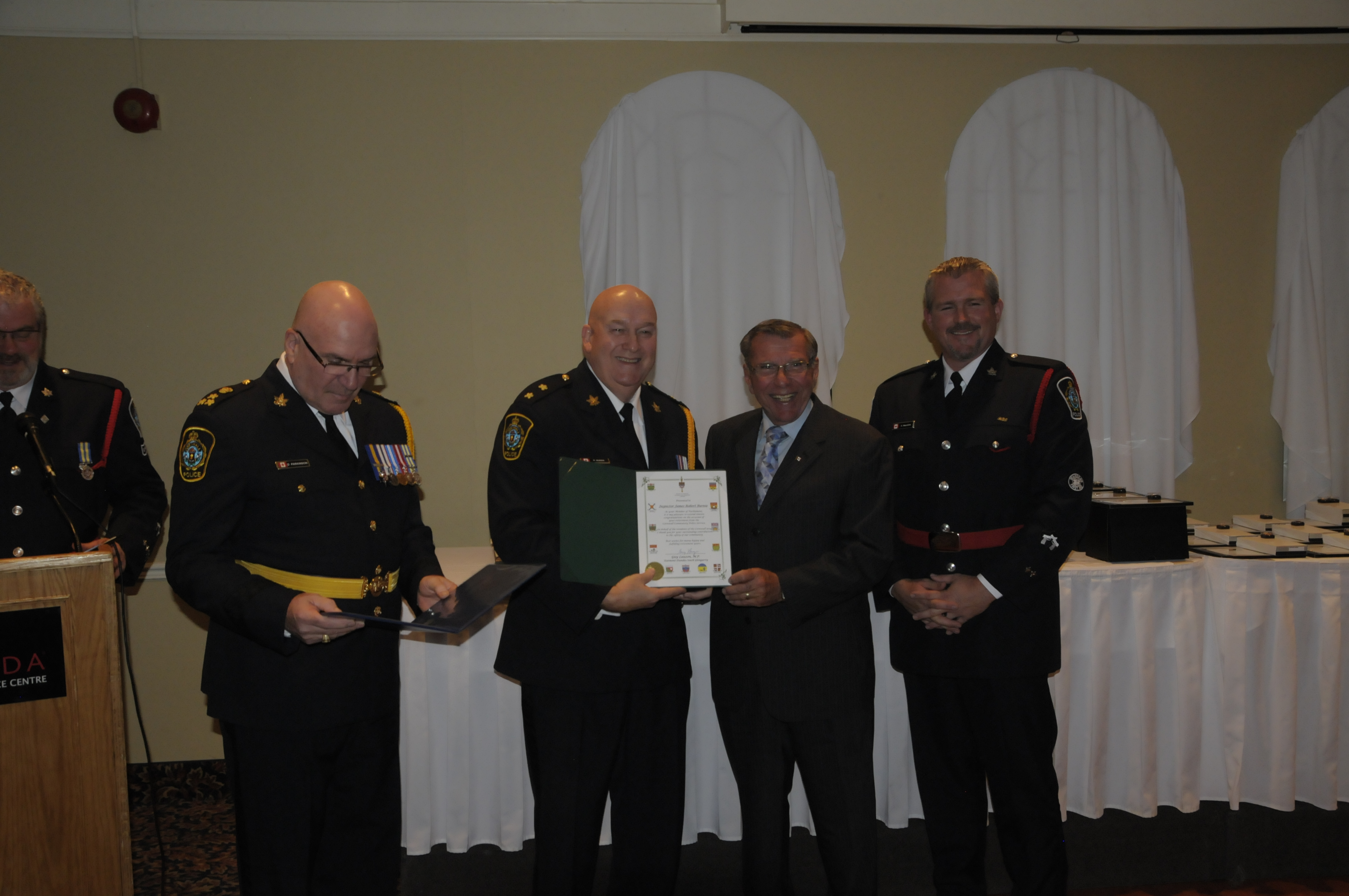 Pictured (from left) are Chief Dan Parkinson, Insp. Bob Burnie (Ret.), MP Guy Lauzon, CPA President Dave MacLean. (Cornwall Newswatch)