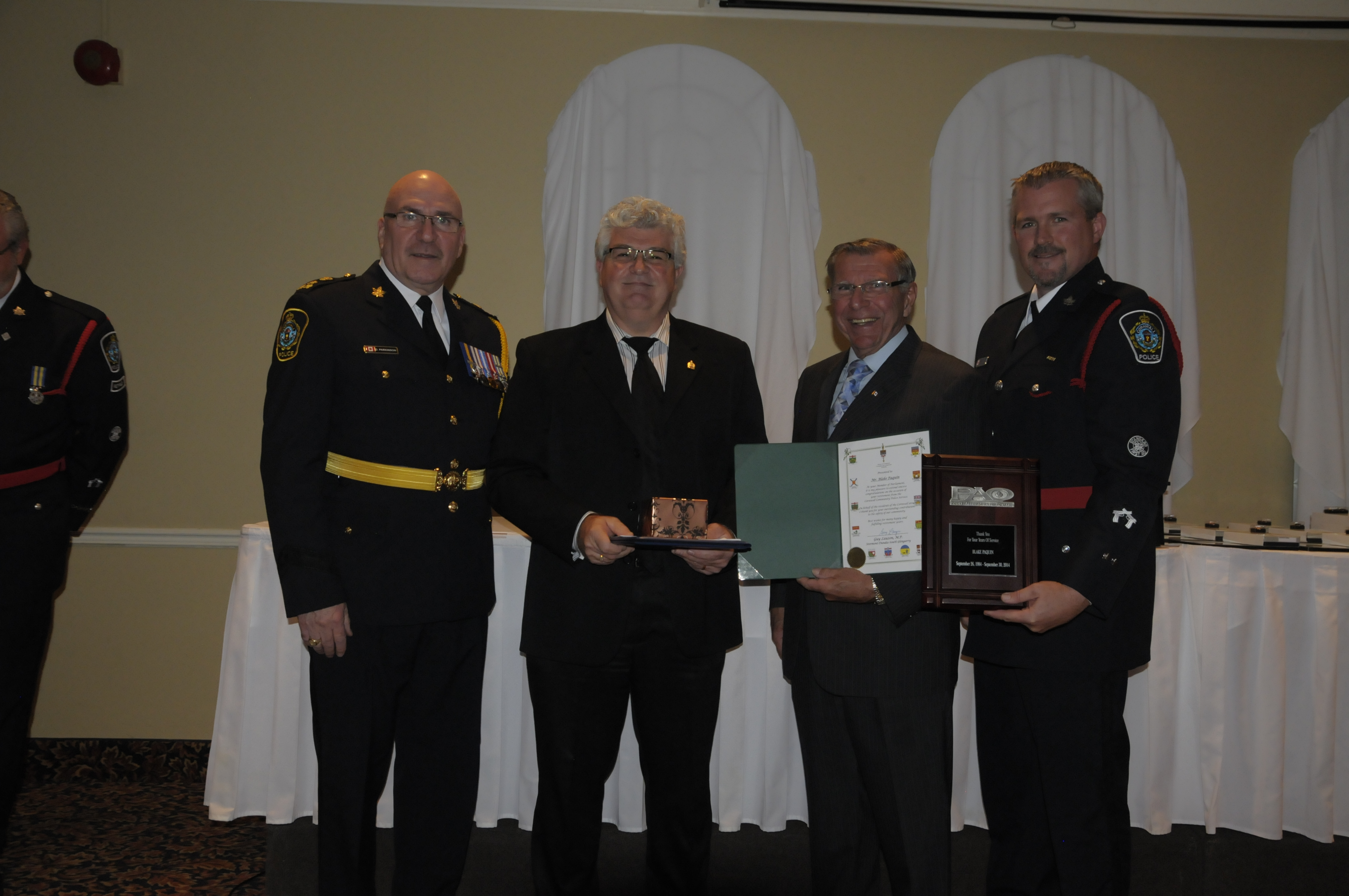 Pictured (from left) are Chief Dan Parkinson, Blake Paquin (Ret.), MP Guy Lauzon, CPA President Dave MacLean. (Cornwall Newswatch)