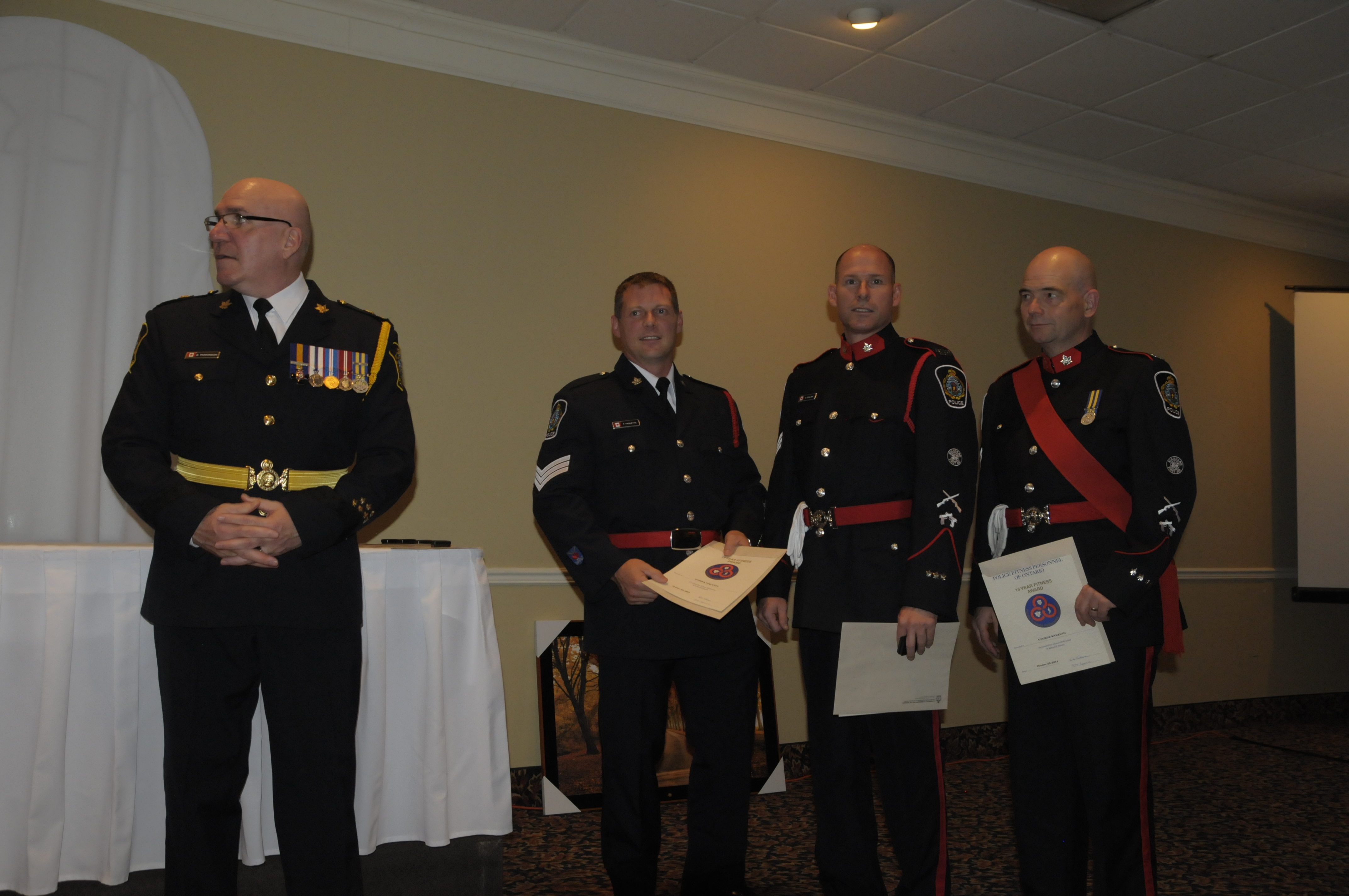 Police Chief Dan Parkinson (left) with the 15 year police fitness award recipients. They are (from left) are Const. Patrick Paquette, Sgt. Scott Coulter and Sgt. George Knezevic. (Cornwall Newswatch)