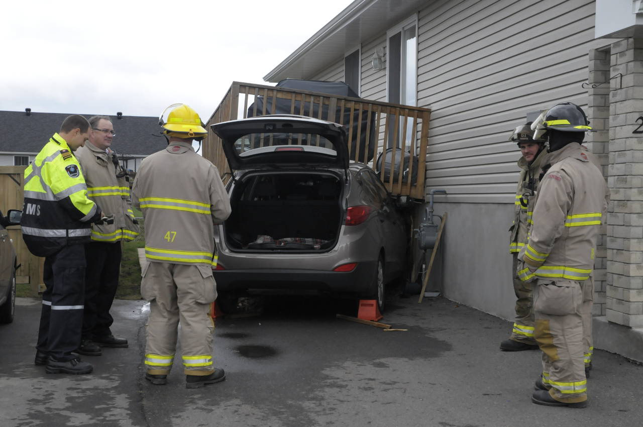 The driver of this SUV miraculously walked away after smashing into a deck at a home in east-end Cornwall on Nov. 7. Police are treating it as an accident. (Cornwall Newswatch)