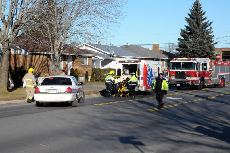 One of the two people in a Hyundai Santa Fe is loaded into an ambulance after a crash Dec. 30, 2014 at the corner of Marleau Ave. and Guy St. (Cornwall Newswatch/Bill Kingston)