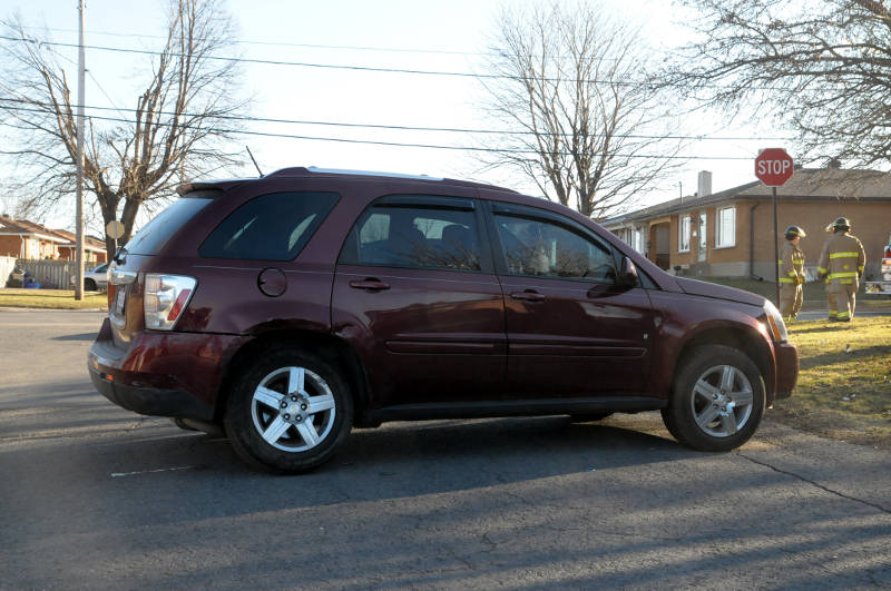 A Chevrolet Equinox sits on Guy St. after a crash involving another vehicle at the intersection of Marleau Ave. The Dec. 30, 2014 crash sent two people to hospital. (Cornwall Newswatch/Bill Kingston)