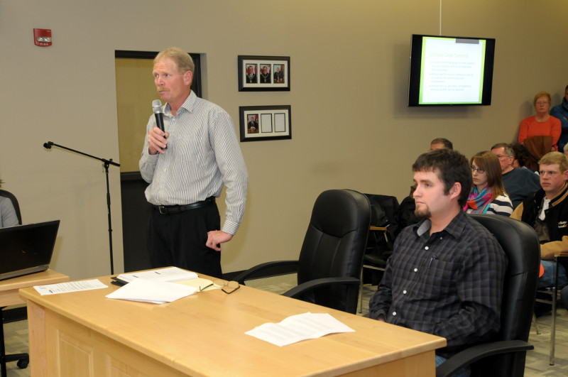 Farmers Steven Byvelds, standing, and Warren Schneckenburger make a presentation to South Dundas council in support of the grain terminal on Lakeshore Dr. They say the project will bring $2 million in economic spinoff to the region. (Cornwall Newswatch/Bill Kingston)