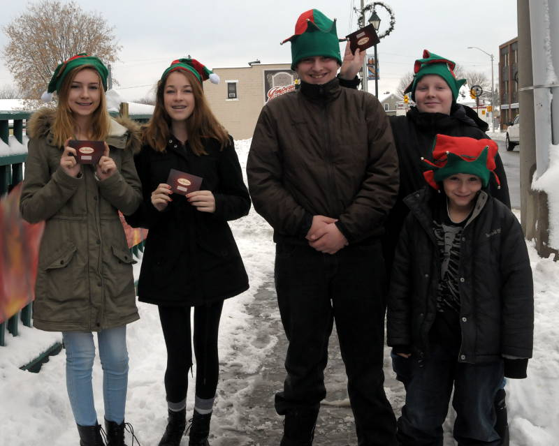 Some of the Holiday Cheer Mission 'elves' distributing Tim Hortons gift cards on Dec. 14, 2014 were, from left, Haley Leger, 14, Kaitlyn Gilligan, 14, Fallin Morin-Michaud, 12, Sebastian Dupuis, 11, and Devin Morin-Michaud, 10. Click to enlarge.  (Cornwall Newswatch/Bill Kingston)