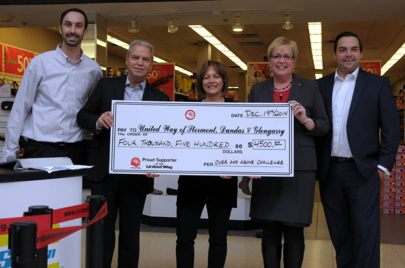 "The Lapointe family were recognized Dec. 19 at Cornwall Square for their work on the ""Over and Above Challenge"" to raise extra money for the United Way campaign. Pictured, from left, campaign chairman Nolan Quinn, Andre and Bev Lapointe of Seaway GM/Seaway Hyundai, United Way Executive Director Lori Greer and campaign co-chairman Luc Lacelle. (Cornwall Newswatch/Bill Kingston)"