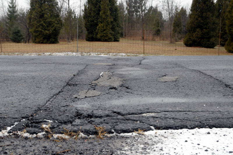 This picture showing a cross-section of Upper Canada Rd. on Dec. 6, 2014 shows pits and heaves in the road. The link between County Road 2 near Upper Canada Village and Highway 401 has been maintained by the St. Lawrence Parks Commission. It was only recently discovered the road is actually owned by the municipality. (Cornwall Newswatch/Bill Kingston)
