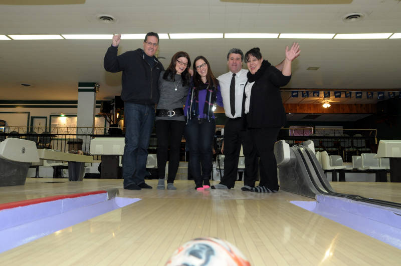 Like the bowling ball heading down the alley, the excitement is building for a chance to strike out a wait list for Big Brothers Big Sisters of Cornwall and District. Pictured, from left, BBBS President Bill Makinson, Honorary Chairwoman Christal Bowen, BBBS caseworker Vanessa Primeau and Tim Hortons franchise owners Nelson and Michelle Matos. The BBBS Bowl for Kids Sake is Feb. 7-8, 2015 in Cornwall and Chesterville. (Cornwall Newswatch/Bill Kingston)