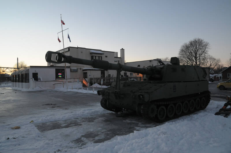The sun sets on the first day of a decommissioned military tank that was delivered to the Royal Canadian Legion on Jan. 20, 2015. The Canadian government gave it to the RCL as part of its decommissioning program. (Cornwall Newswatch/Bill Kingston)