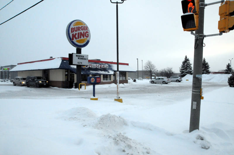 Vehicles line up at the take-out window at the Cornwall Burger King on Feb. 12, 2015. The property has been bought by a Montreal real estate trust for $815,000. (Cornwall Newswatch/Bill Kingston)
