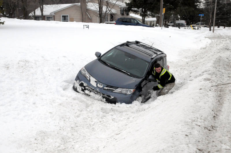Philippe Boyer of Metro Towing hooks up this Toyota SUV which landed in a deep ditch on McConnell Avenue near Cornwall Centre Road on Feb. 18, 2015. The double-SUV crash caused extensive damage to both vehicles but, fortunately, there were no serious injuries. (Cornwall Newswatch/Bill Kingston)