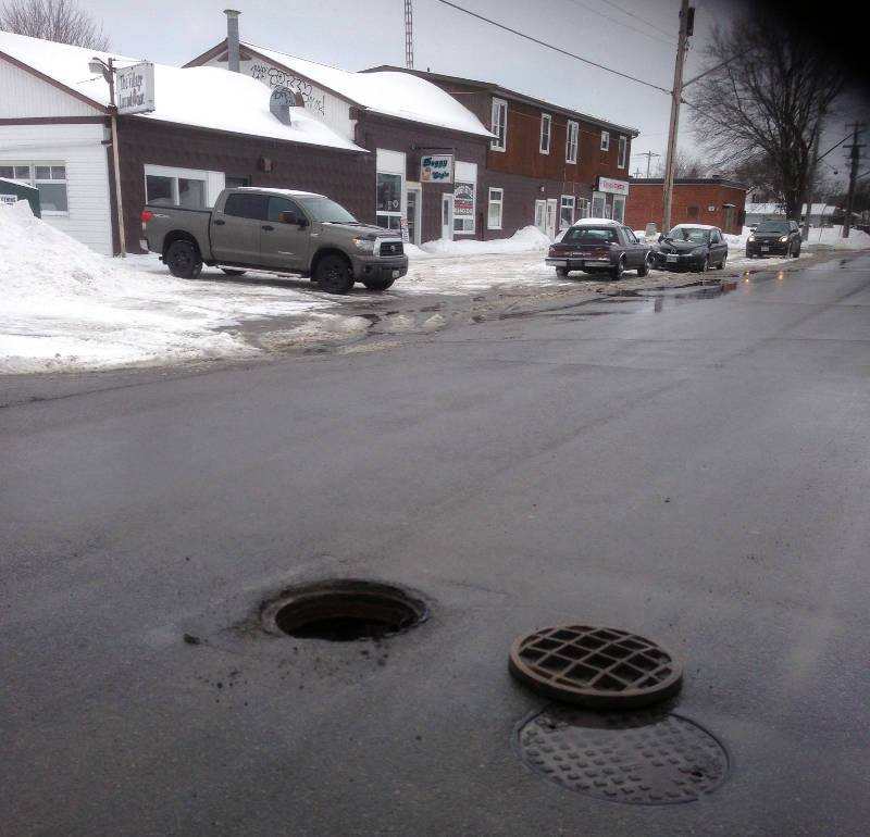 A manhole cover lies on Fifth Street in Morrisburg on Mar. 4, 2015. A witness says at least two cars hit the obstruction. (Photo/Submitted)