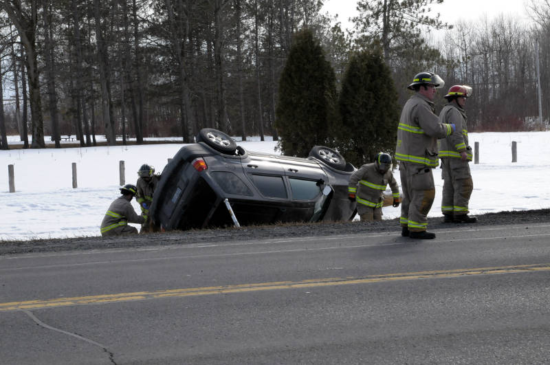 Cornwall firefighters work to brace this Ford Escape SUV after the single vehicle rollover on County Road 2 near Guindon Park. The woman driving was taken to hospital to be checked out as a precaution. (Cornwall Newswatch/Bill Kingston)