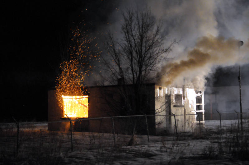 A giant shower of sparks fill the night sky during this warehouse fire on Tenth Street East on March 15, 2015. City police are investigating. (Cornwall Newswatch/Bill Kingston)