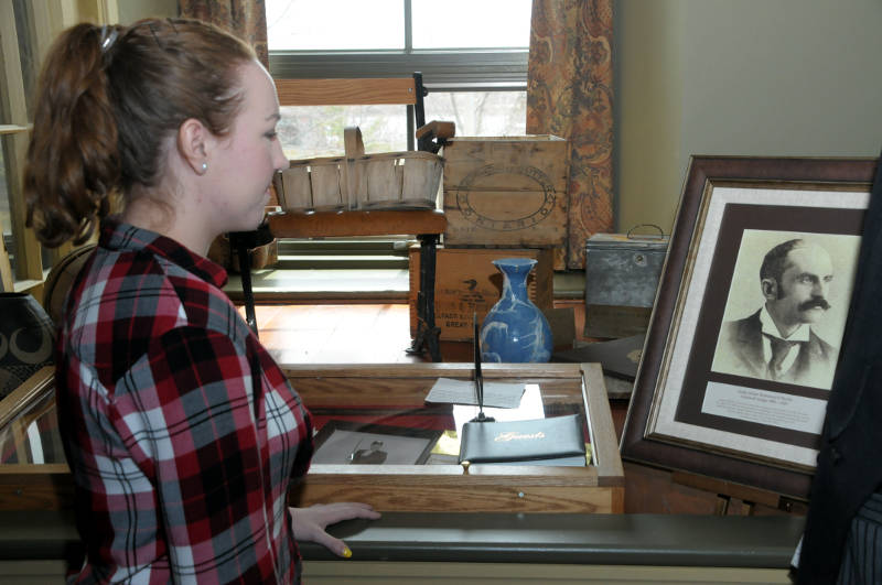 Historian Sara Lauzon takes a moment to admire the portrait of Judge James Redmond O'Reilly on April 23, 2015. It was 86 years ago on this day that Judge O'Reilly died after suffering an asthma attack. (Cornwall Newswatch/Bill Kingston)
