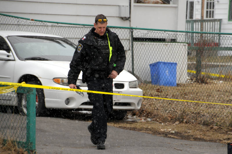 Acting Sgt. Derek Duchesne leaves the scene of a murder on Carleton Street on April 6, 2015. (Cornwall Newswatch/Bill Kingston)