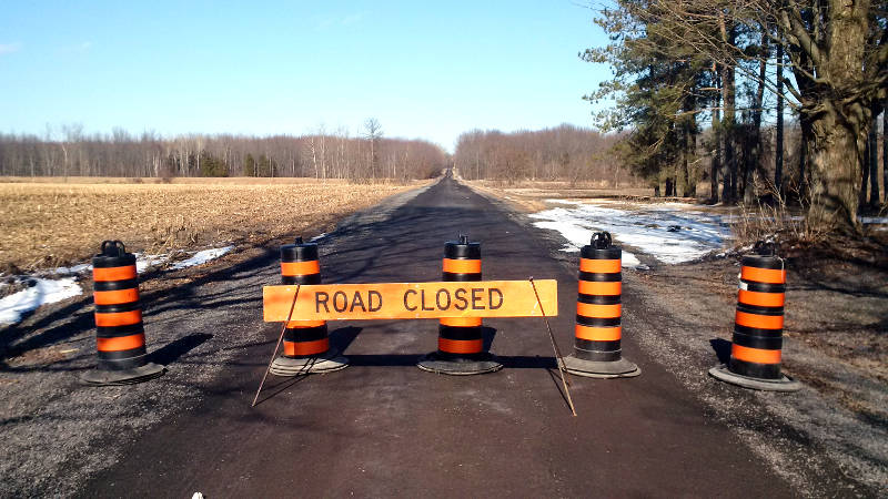 A portion of Zeran Road in South Stormont is blocked off April 5, 2015 after a large washout around a culvert. Township crews are expected to make repairs soon. (Cornwall Newswatch/Bill Kingston)