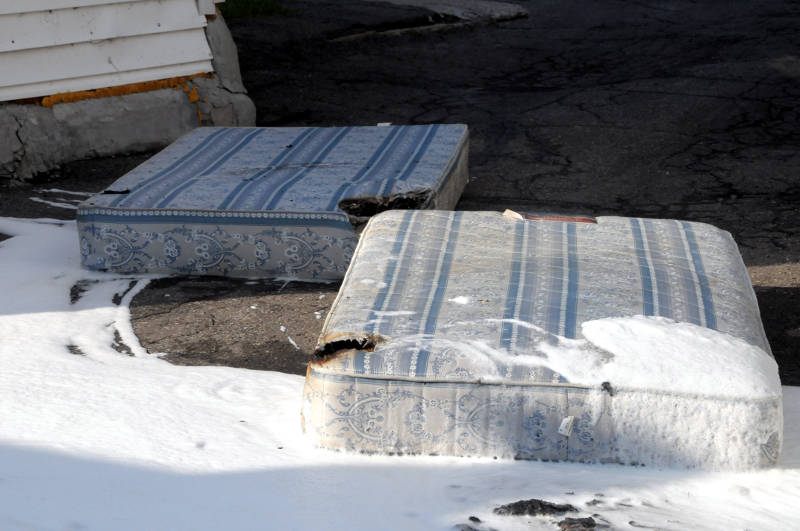The mattress and box spring lay in the driveway of a Prince Arthur Street home after a fire on May 28, 2015. The homeowner was treated by paramedics for smoke inhalation. The fire department says the cause was careless smoking. (Cornwall Newswatch/Bill Kingston)