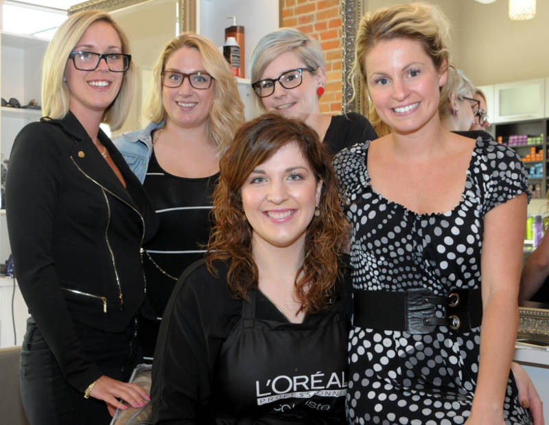 Employees at The Loft Salon are fundraising to help a family whose baby is being treated for a stage four brain cancer. Pictured, from back left, Milaine Boyer, Alex Besner, Jessica O'Brien, Melissa Cameron Mainville and, front center, Chantale Leger. (Cornwall Newswatch/Bill Kingston)