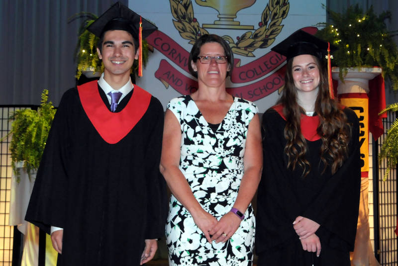 CCVS Principal Trish Brown, center, with co-valedictorians Randy Schmucker and Ainsley Hunt. The two graduates were among 112 students to receive their high school diploma June 25, 2015 during a ceremony at T.R. Leger School on Cumberland Street in Cornwall, Ont. (Cornwall Newswatch/Bill Kingston)