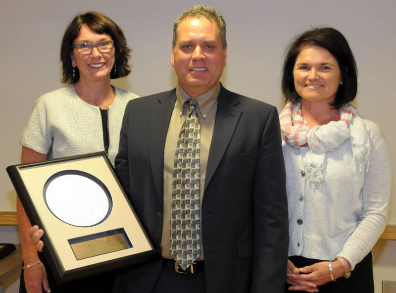Podiatrist Michael Turcotte, center, with Cornwall hospital CEO Jeanette Despatie, left, and hospital board vice chairwoman Melanie Baker Brown. Turcotte received the plaque June 18, 2015 for his 10 years of service on the hospital board. (Cornwall Newswatch/Bill Kingston)