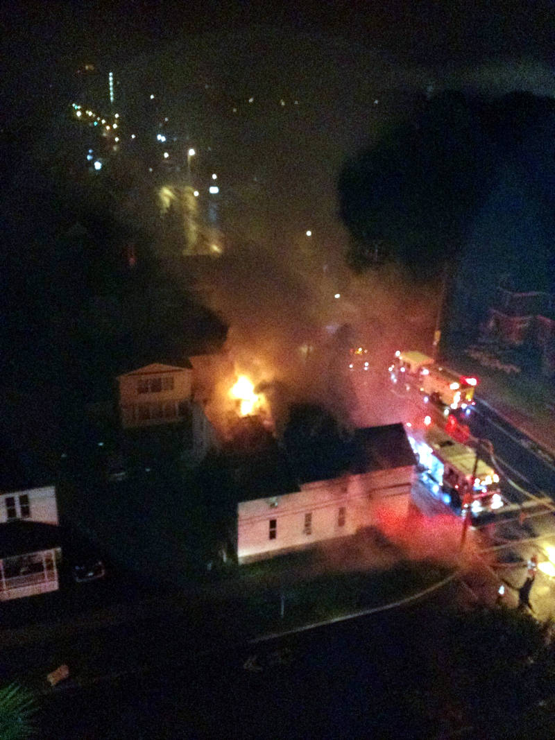 Flames and smoke cut through the sky just before dawn on July 18, 2015 after this four-plex fire. (Photo/Reynald Roy)