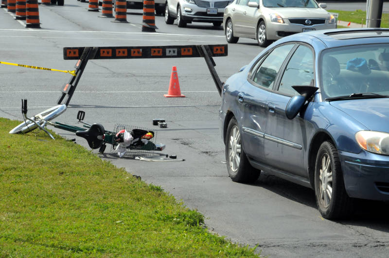 Looking south on Sydney Street, a bicycle lays on the grass after a collision with this sedan just north of the intersection at Ninth Street on July 14, 2015. (Cornwall Newswatch/Bill Kingston)