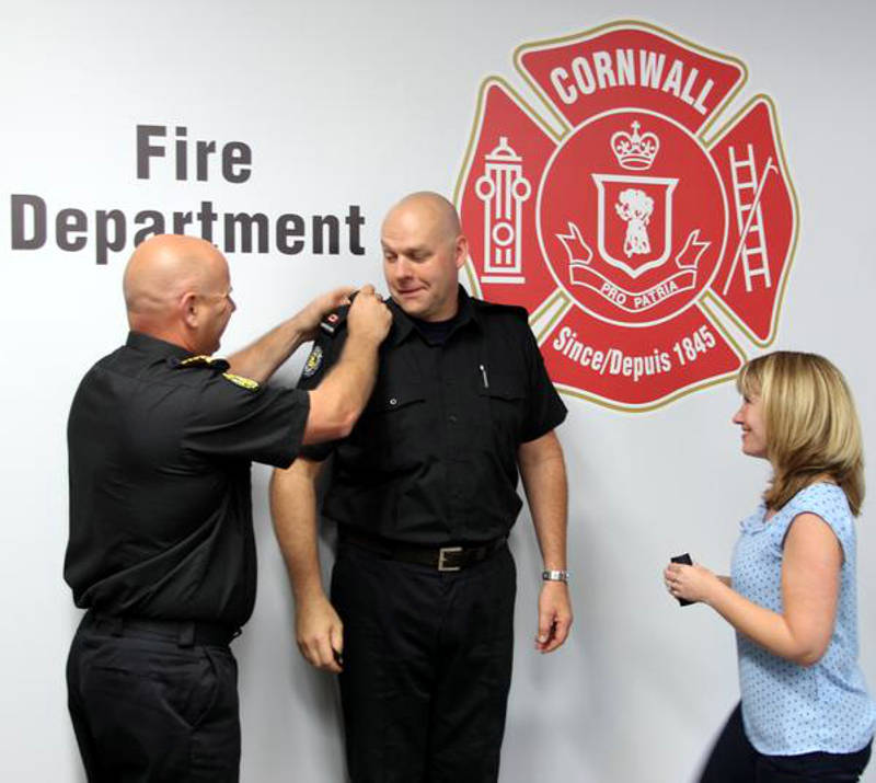 Fire Chief Pierre Voisine, left, places the rank insignia on Bruce Donig, who has been appointed deputy fire chief effective July 2, 2015. (Photo/City of Cornwall)