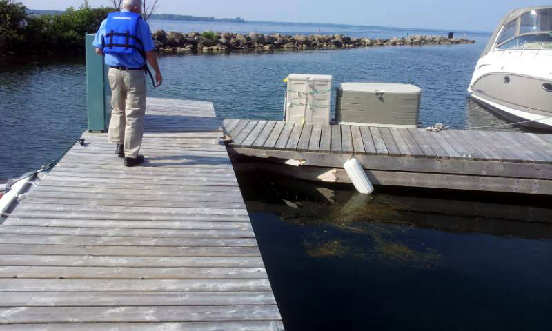 Some docks were smashed up against each other as a short-lived but intense storm struck July 13, 2015 at the Crysler Park Marina, east of Morrisburg, Ont. The storm also uprooted trees. (Photo/CBOC Marine/@CdnBayliner/Twitter)