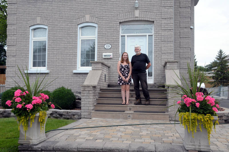 Sara Lauzon is joined by the current co-owner of 219 Sydney Street, Gordon Chisholm. Chisholm sat down with Lauzon Friday afternoon to share some of the history and improvements that have been made to the house since his wife, Largaret Lough, and her brother purchased the property in 1989. (Cornwall Newswatch/Bill Kingston)