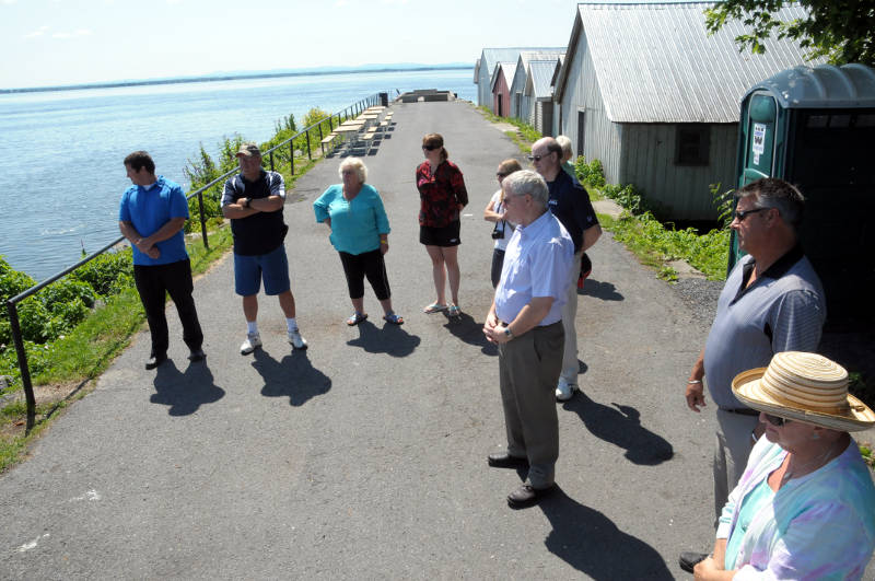 A small group of dignitaries and stakeholders stand on the South Lancaster Wharf July 16, 2015 to mark the opening of a new floating dock (not shown). (Cornwall Newswatch/Bill Kingston)