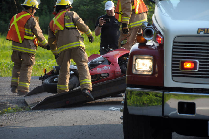 South Glengarry firefighters recover a sportbike from a deep ditch on South Service Road on July 5, 2015 after a single vehicle crash. The rider was taken to hospital with non-life threatening injuries. (Cornwall Newswatch/Bill Kingston)