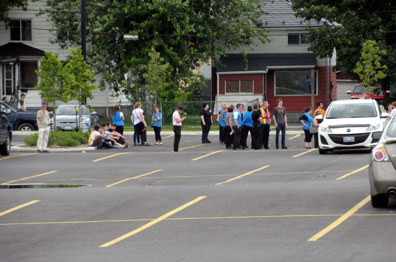 Cornwall Walmart associates stand in the northeast corner of the parking lot on Ninth Street and Cumberland Street after the store received a bomb threat July 18, 2015. (Cornwall Newswatch/Bill Kingston)