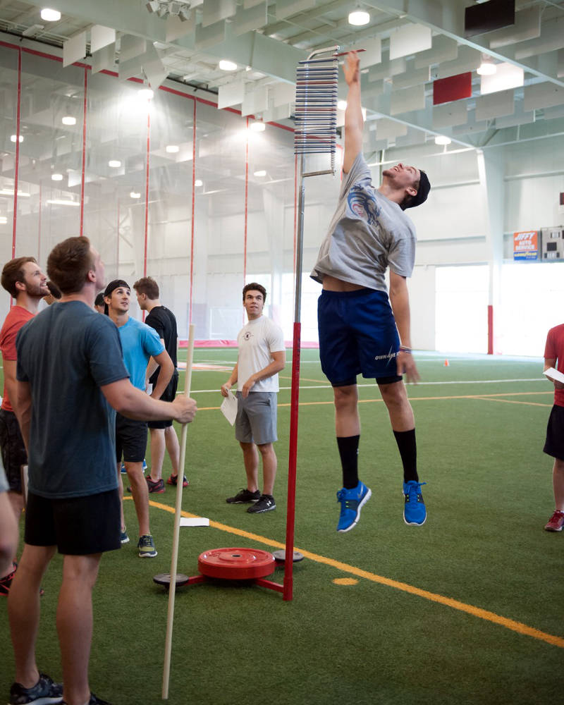 Veteran Colts star Grant Cooper showcases his leaping ability during the fitness testing portion of the 2015 Colts training camp at Benson Center. Returning Colts stars Lawson MacDougall and James Edwardson along with Own The Ice Head Strength and Conditioning Coach Ian Perry look on. (Photo/Supplied)