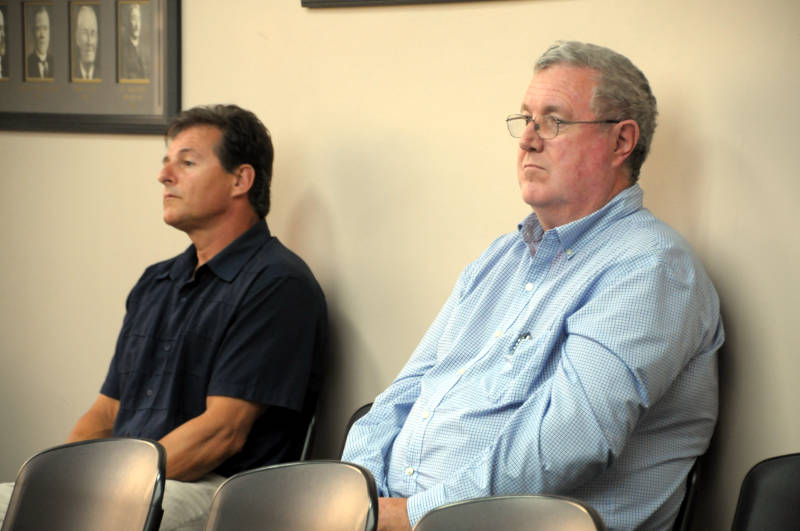 Tri-Co Sports Cornwall Ltd. principal Paul Vincent, left, and agent Sandy Cameron listen to a question from a PAC committee member on Aug. 24, 2015. Cameron said the owner's intention is to sell the building to a developer once the zoning paperwork is complete. (Newswatch Group/Bill Kingston)