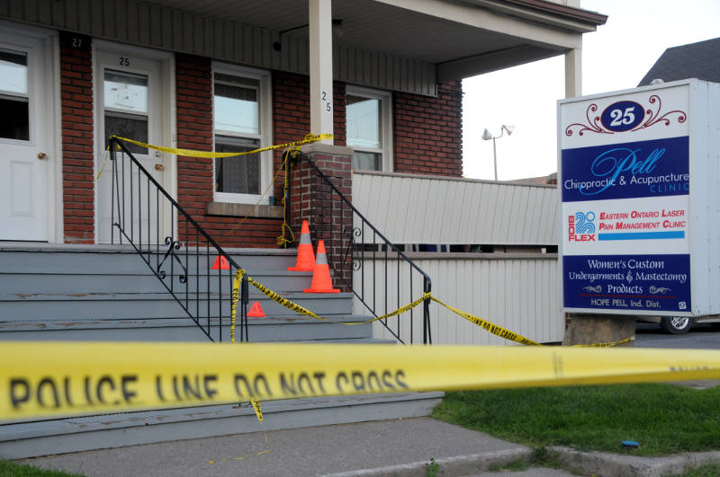 Two evidence markers are placed on the steps leading into this apartment building and business on Aug. 3, 2015 after a man died. The regional coroner is investigating the death. (Cornwall Newswatch/Bill Kingston)