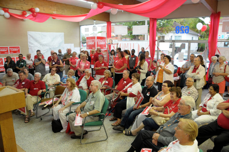 An energetic crowd listens to SDSG Liberal candidate Bernadette Clement (not shown) speak during the opening of her campaign office at 628 Pitt Street in Cornwall, Ont. (Newswatch Group/Bill Kingston)
