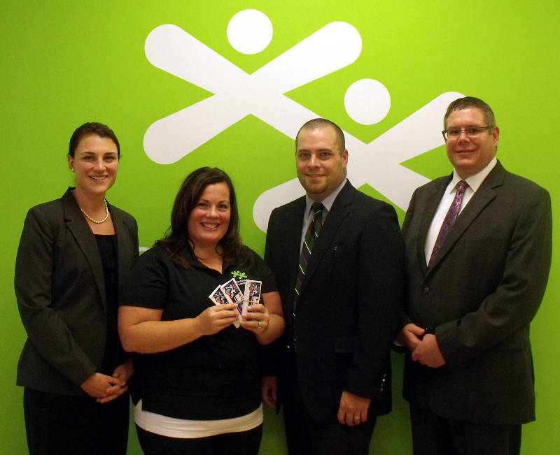 Pictured from left are Erin Lalonde of CKDM, Jacquie Richards of Boys and Girls Club, and Paul Desnoyers and Jamie Pollock of CKDM. The accounting firm has donated hockey tickets to help youth enjoy local hockey. (Photo/Supplied)