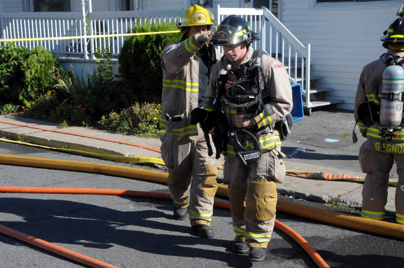 Cornwall firefighter Addison Pelkey rescues a puppy from a duplex after a bedroom fire in an adjoining unit. Pelkey reunited the puppy with its owner Sept. 23, 2515 shortly after this photo was taken. (Newswatch Group/Bill Kingston)