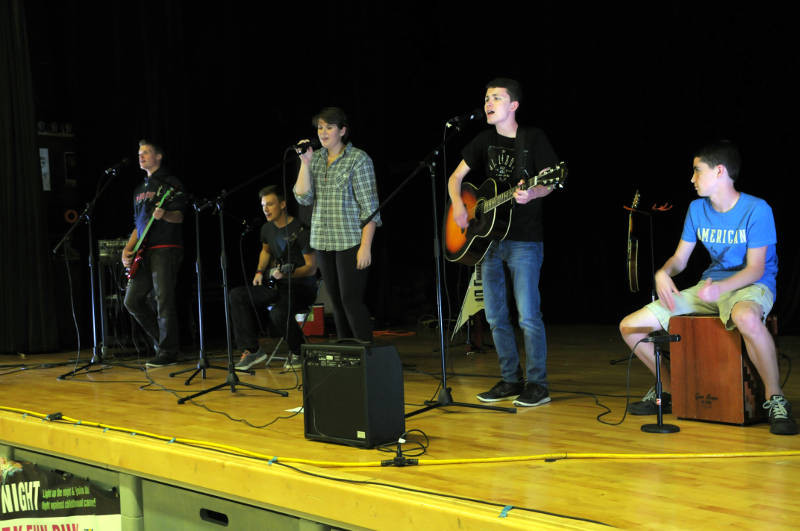 "Local band ""Put it in Park"" performed at Holy Trinity Catholic Secondary School during the Neon Night evening walk, raising money for childhood cancer research. (Newswatch Group/Bill Kingston)"