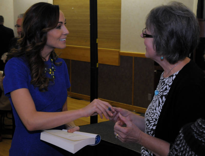 Amanda Lindhout signs a copy of her book for a supporter on Oct. 21, 2015 during the Children's Treatment Center Celebrity Walk & Breakfast at the Cornwall Civic Complex. (Newswatch Group/Bill Kingston)