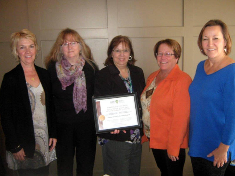 EOHU Workplace Health Liaison Darleen Seguin, center, presents Glengarry Memorial Hospital gold designation award. Receiving the award are, from left, Wendy Shields, Dale Eastwood, Linda Morrow (Hospital CEO) and Louise Quenneville. (Photo/Supplied)