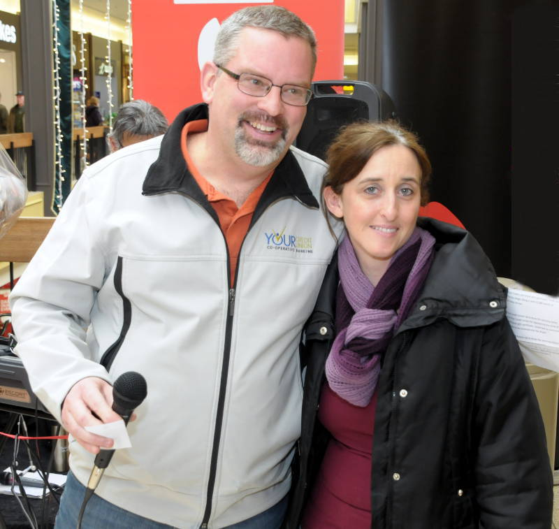 United Way of SD&G campaign chairman Michael Galvin congratulates Julie Lapierre of Cornwall Dec. 18, 2015 on winning the $5,000 Celebration Sleigh during a draw at Cornwall Square. The United Way campaign has been extended until Jan. 15, 2016. (Newswatch Group/Bill Kingston)