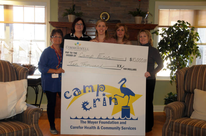 Members of Camp Erin receive a $10,000 cheque from Commonwell Mutual Insurance Group Monday, Feb. 22, 2016 in Cornwall. Ont. Making the presentation are Camp Eric director Michele Smith and Commonwell members Miki Paczek, Kate Ryan, Rachelle Joanette and Angie White. (Newswatch Group/Bill Kingston)