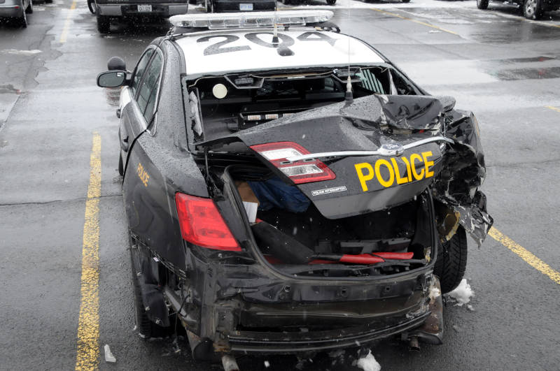 The wreckage of an SD&G O.P.P. police cruiser sits at the Long Sault, Ont. detachment on Thursday, Feb. 25, 2016. The officer and a citizen, in the cruiser at the time, were hit from behind on Highway 401 during a freezing rain storm the day before. (Newswatch Group/Bill Kingston)