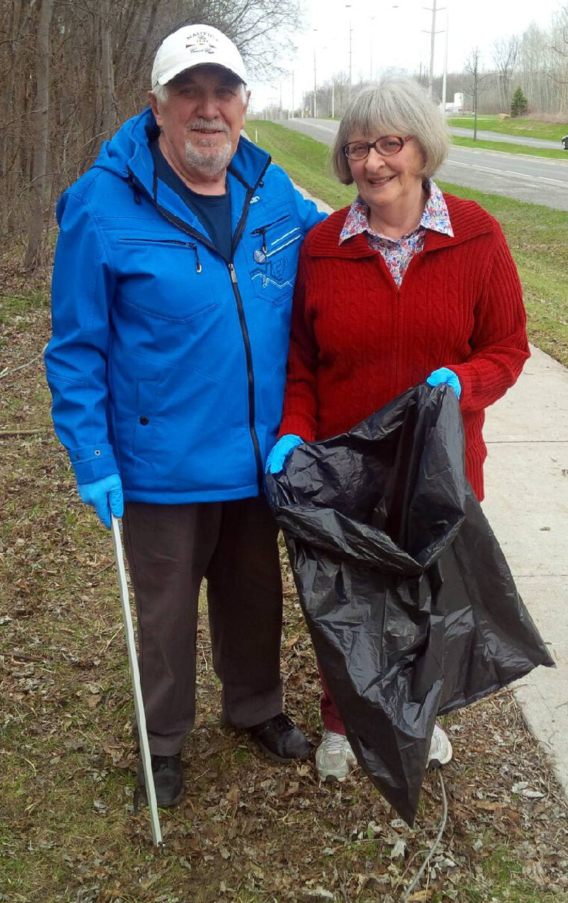 In this April 29, 2016 photo provided by the City of Cornwall, the Millards pick up trash as some of the first members of the Adopt-A-Street program in Cornwall. The city is looking for people to sign up to make the city more beautiful. (City of Cornwall via Newswatch Group)