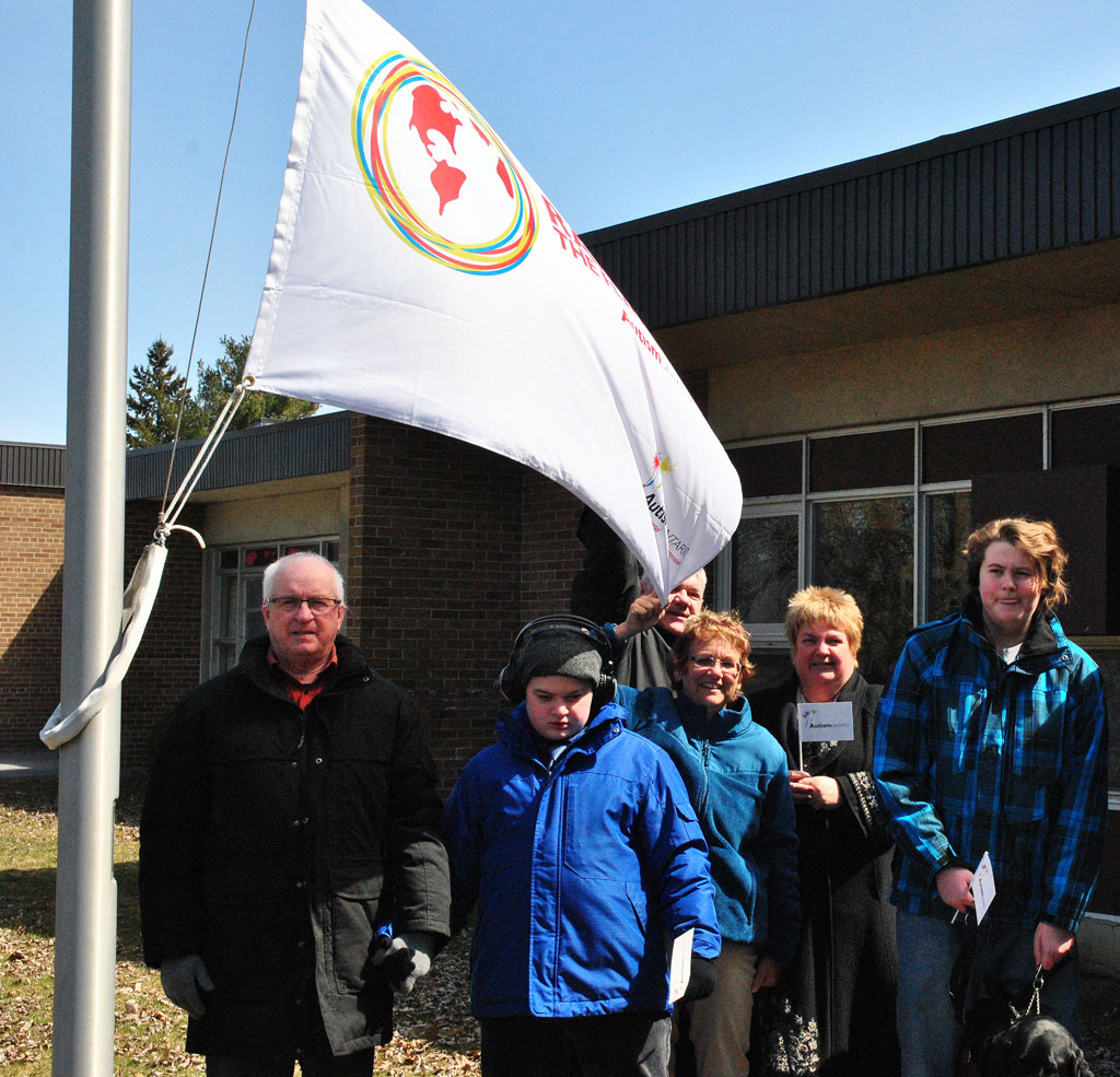Staff, students and members of the community raise a flag for Autism Awareness at Seaway District High School. – Phillip Blancher/Cornwall Newswatch