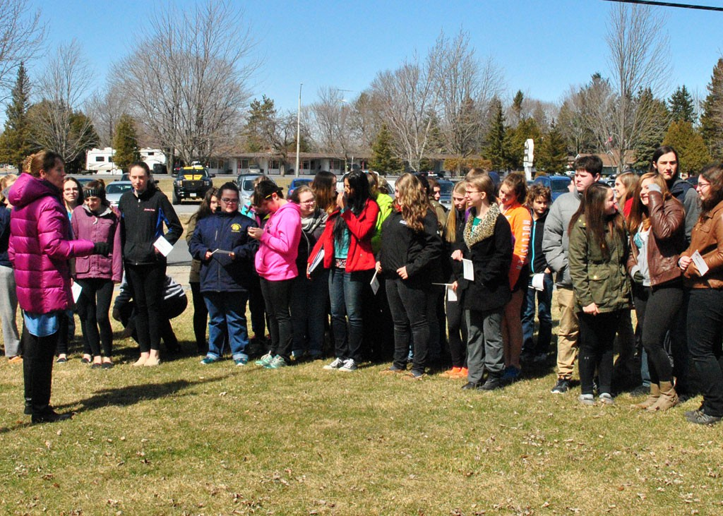 Seaway District High School Vice-Principal Tania Stover(left) addresses students during Monday's Raising the Flag event promoting Autism awareness. - Phillip Blancher/Cornwall Newswatch