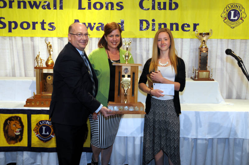 Members of RBC present the trophy and $1,000 bursary to Shana Krol. Krol was recognized for her scholastic and athletic achievement with an overall grade of 94 per cent and her sporting achievements in volleyball and javelin. (Newswatch Group/Bill Kingston)