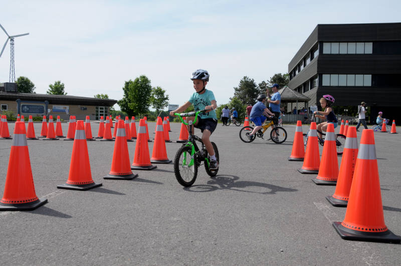 A young participant heads through the obstacle course Saturday, June 4, 2016 during the Bikes and Badges event at St. Lawrence College in Cornwall, Ont. The bicycle safety event saw its biggest crowd to date. (Newswatch Group/Bill Kingston)